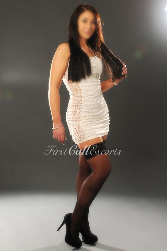 Sophisticated English Escort In White Dress